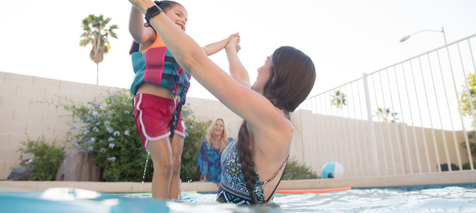 Photo of a women and child in a pool